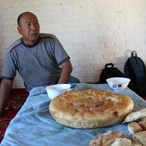 Uigur man with bread